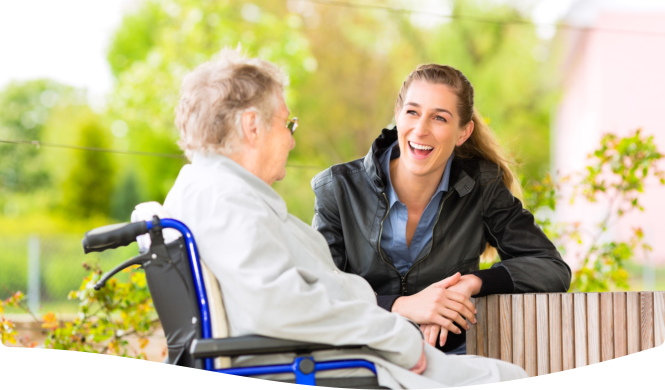 patient and caregiver smiling