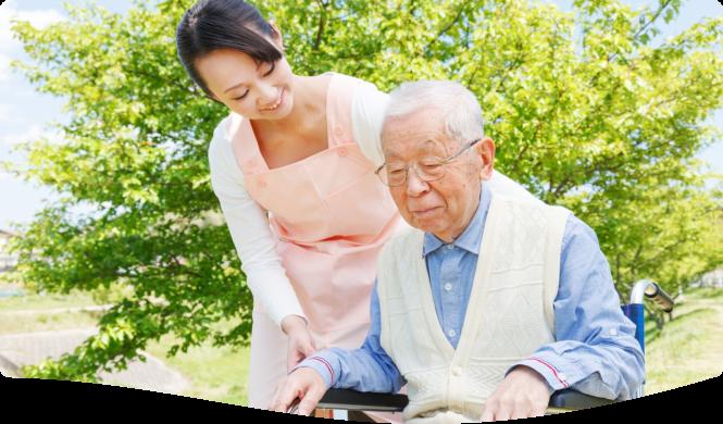 caregiver assisting her elderly patient