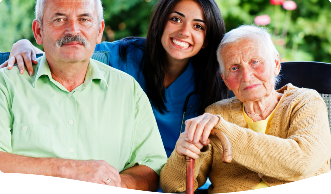 elderly couple and caregiver smiling